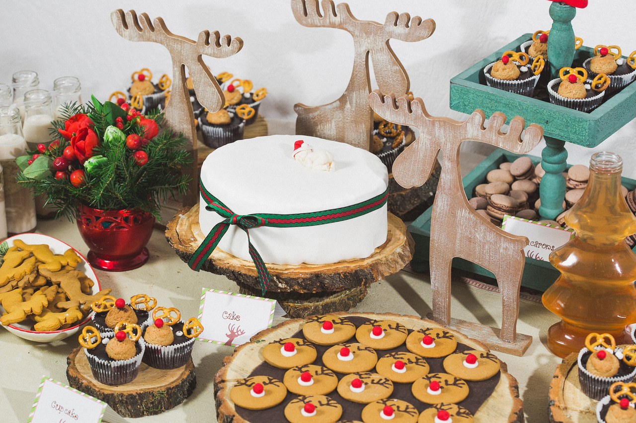 Cookie Exchange table ideas. Set up a buffet with a festive tablecloth, cupcake stands, and labels for each type of cookie.